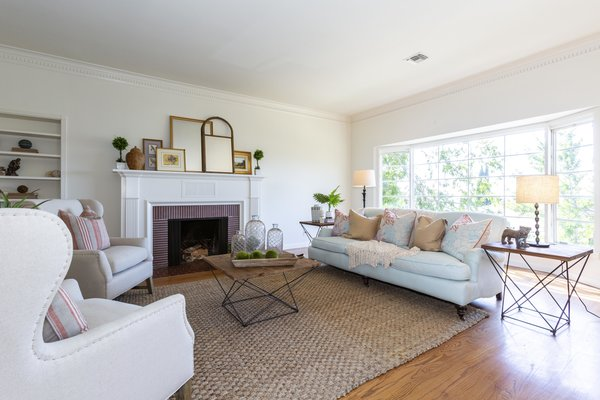 The formal living room features one of the home's two fireplaces.
