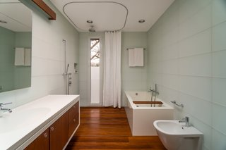 In the master bathroom, water from the shower drains straight through the wooden floor slats.