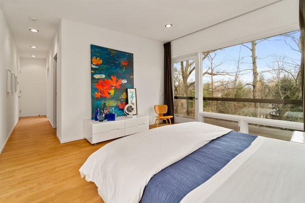 A Gl Door In The Master Bedroom Opens To Small Terrace
