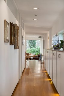A bright hallway lined with storage leads to the kitchen.