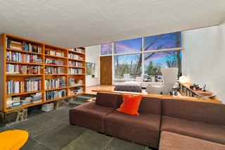 The open, flexible floor plan preserves clear sight lines to the woods outside.
