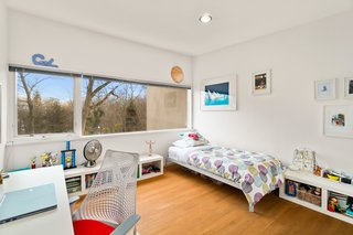 The bedrooms are bright with natural light.