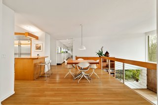 The loft-like second-floor kitchen is flooded with natural light.