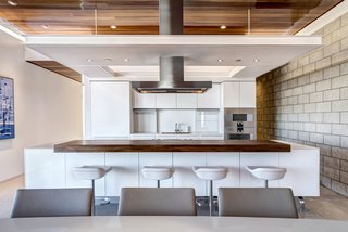 The custom Bulthaup kitchen is outfitted with Gaggenau appliances and Caesarstone countertops.