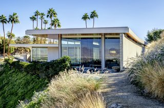 Perched on a hillside, the midcentury-inspired home is well integrated into the natural landscape.