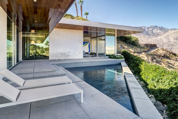Outside, a triangular saltwater pool overlooks breathtaking views.