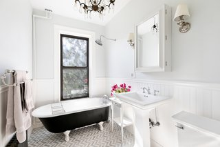 Thebright, updated bathroom comes with a clawfoot tub.
