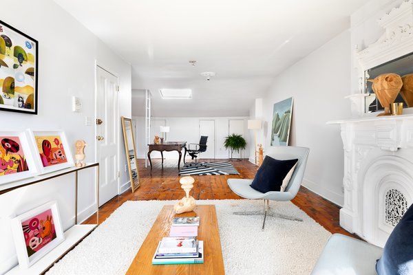 The third floor features an open, loft-like studio space with a full bath and plenty of storage.