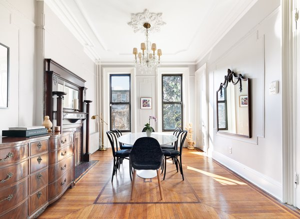 At the opposite end of the parlor level is the dining room.