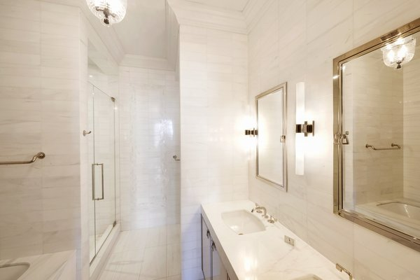 The Master Bedroom Suite Has A Spa Like Bathroom With Floor To Ceiling