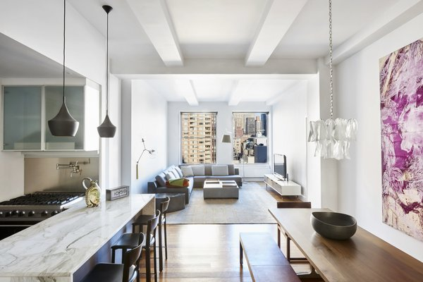 The open-plan layout is bright and airy thanks to high ceilings and oversized windows.