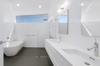 The master bath features a Duravit/Philippe Starck bathtub and a wall-mount toilet.