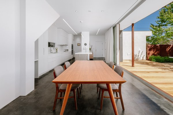 A Fully Operable Wall In The Dining Room Brings Natural Light And Gentle Breezes