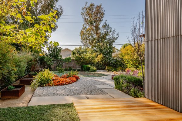 The enclosed garden features lovely landscaping and has the feeling of a serene escape.