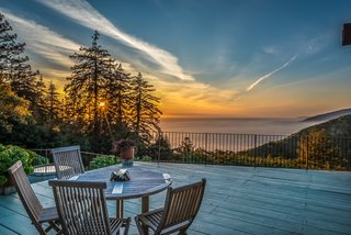 The deck features panoramic views of the Pacific Ocean, the forested mountains of Los Padres National Park, and breathtaking sunsets.