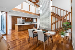 The open-plan layout features a double-height central space.
