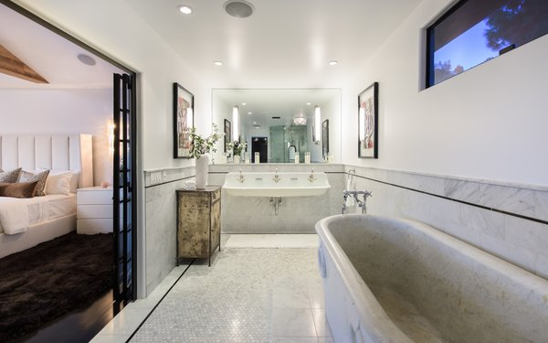 The master bath features marble throughout, including a deep marble soaking tub.