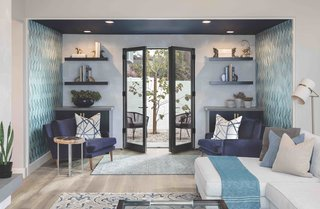 "The former dining room was converted into a sitting nook just off the living room, which the family now affectionately refers to as the ""parlor."" Kolbe french doors provide outdoor access."