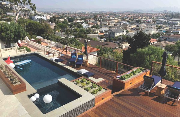 The new pool was raised six feet above the ground and was designed for entertaining—and to better match the home's new modern style.