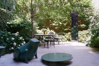 The garden, designed by Harrison Green, has a toad chair and a lily pad by François-Xavier Lalanne.