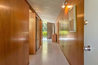 The entry hall is clad in original Philippine mahogany paneling for a warm, authentic midcentury vibe.