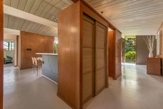 The home features original wood-paneled closets with Japanese-style sliding doors.