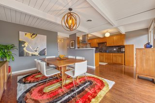 The Kitchen And Dining Room Feature An Open Plan Layout.
