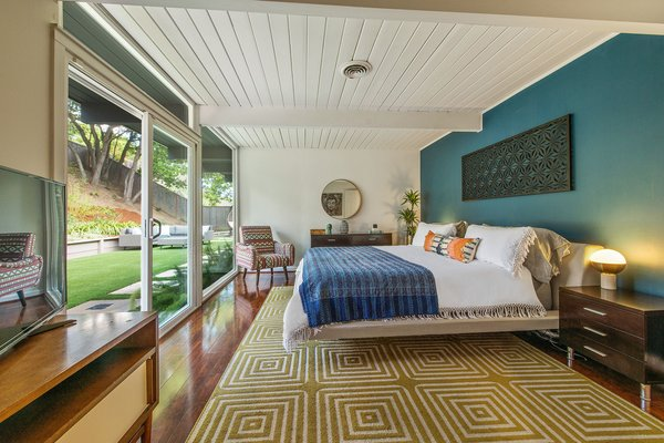 The master bedroom also has sliding glass doors leading to the yard.