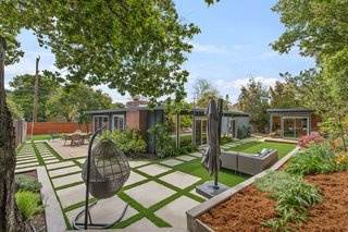 The beautifully landscaped backyard features a few separate sitting areas—perfect for entertaining and indoor/outdoor living.