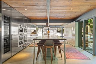 Tongue-and-groove ceilings reference the home's midcentury roots.