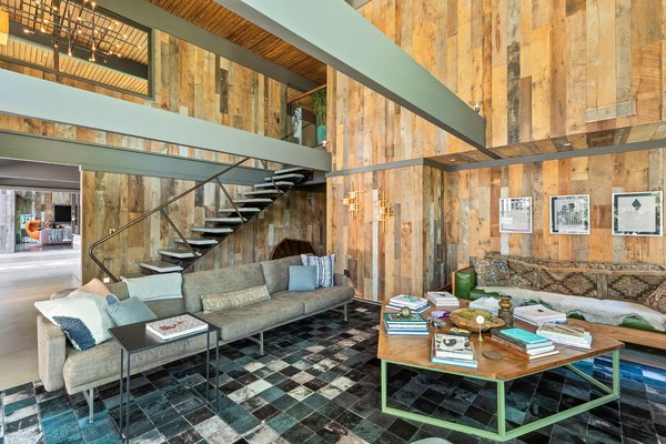 The reclaimed oak paneling in the double-height living room plays off the painted beams.