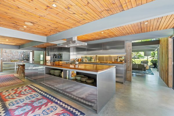 The kitchen features a 24-foot-long counter made of stainless steel and walnut.