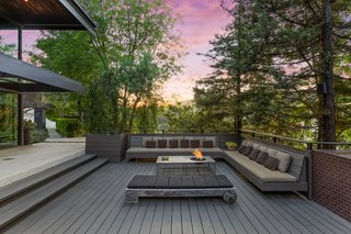 There is even a fire pit with seating for outdoor entertaining.