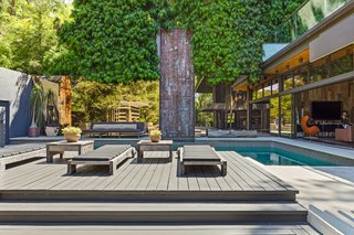 The main pool deck seamlessly transitions into the den.