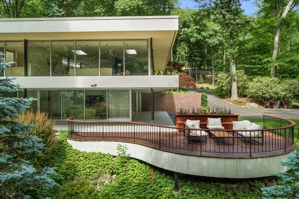 The terrace provides a quiet place to enjoy the forested surroundings.