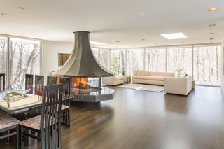 A circular fireplace takes center stage in the living room.