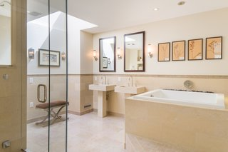 The serene master bath has dual sinks, a Japanese soaking tub, and a steam shower.