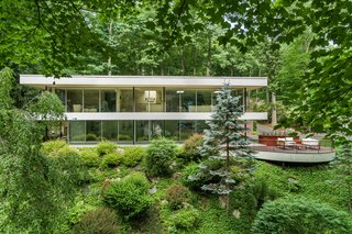 The 5,000-square-foot midcentury home sits on 2.24 acres of woodland in Armonk, New York.