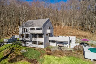 Built in 1975, the 2,750-square-foot house is set on a private, forested lot in the Berkshires.