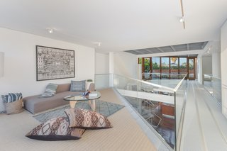 The lofted upper level offers additional living space.