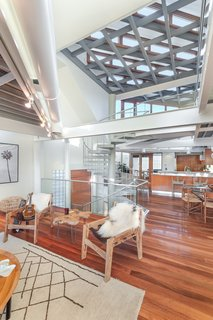 Natural light suffuses the open-plan, double-height living area.