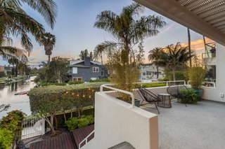 The canal-facing patio soaks up picturesque sunset views.