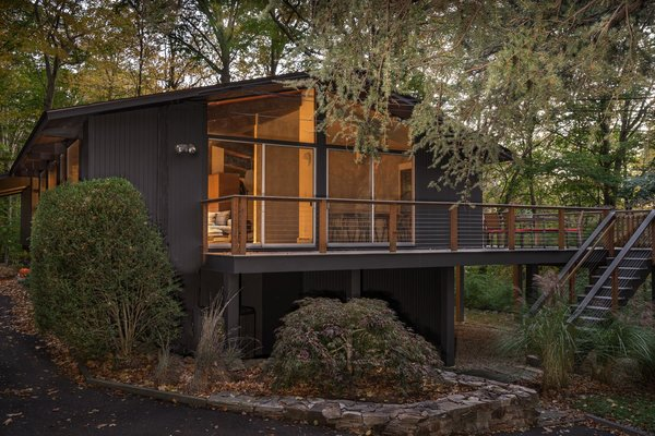 The post-and-beam home has a classic midcentury profile.