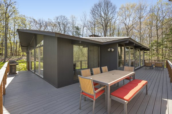 The Trex elevated wraparound deck is perfect for indoor/outdoor entertaining.