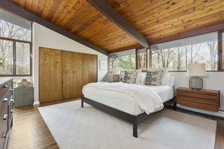 The master bedroom is awash with natural light and filled with warmth from the tongue-and-groove ceilings.