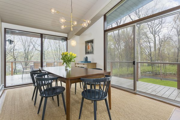 The dining room opens to the wraparound deck.