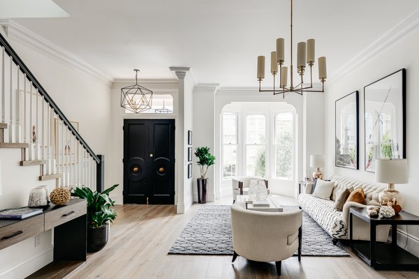 An elegant sitting room lies just off the entryway.