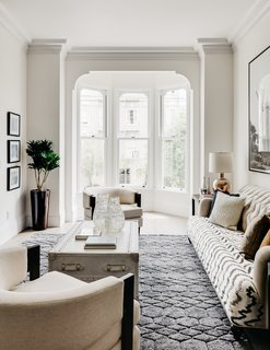 Large bay windows fill the interior with daylight.