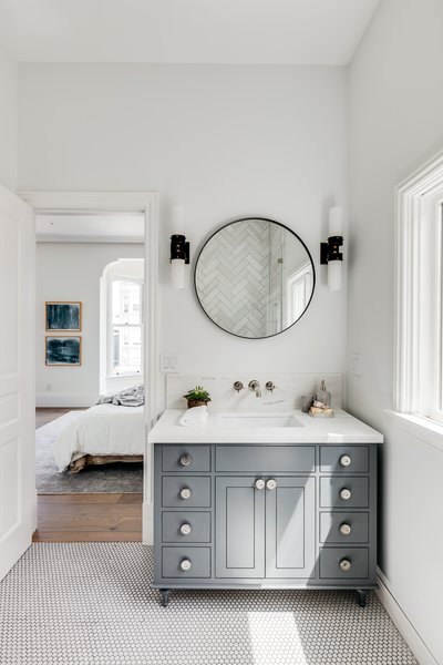 The master bath features penny tiles on the floor.
