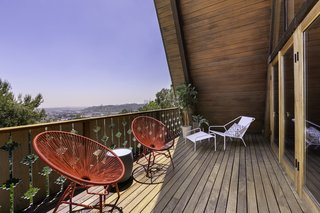 The porch features spectacular views of the canyon and downtown Los Angeles.